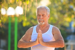 Older man in yoga pose shutterstock 737381545 web