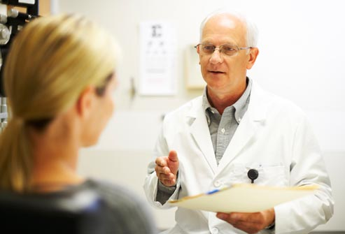 getty rf photo of doctor talking to woman