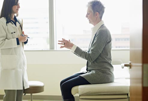 getty rm photo of woman talking to doctor